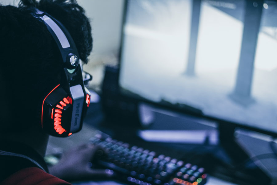 man gaming on computer